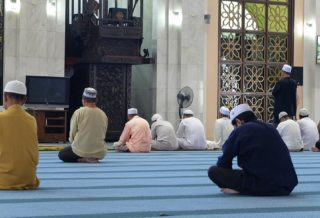 People sitting in Mosque (Masjid)